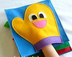 Pagina di libro tranquillo Mitt guanto della mano