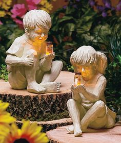 """Kids with Solar FirefliesStatues - Adorable statues made from cold cast ceramic. The boy measures 9-7/8"""" x 7 1/2"""". The girl measures 9-7/8"""" x 8-1/8"""" x 5-1/2"""". Each child holds a clear glass jar with a solar powered firefly inside. $ 10.95 each from LTD Commodities."""
