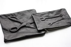 I made these clutches for my exam last year. Here is a small DIY guide, have fun:    http://passionsforfashion.dk/2011/05/diy-guide/