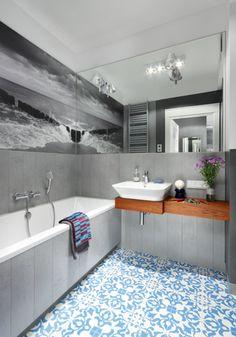 grey bathroom with blue Morrocan tiles on the floor