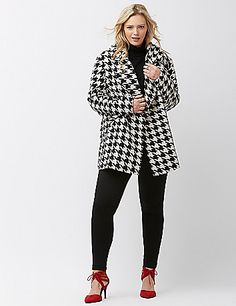 Sophisticated black & white houndstooth coat warms up your chilly weather look with plenty of check-me-out attitude. Snap closure. Slash pockets. lanebryant.com