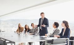Stock Photo : Businessman leading meeting in conference room