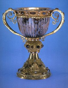 The Chalice of Abbot Suger (c.1140) is made of Silver gilt with jewels, and stands 19cm in height. The cup is formed from Agate.