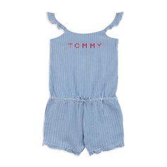 TOMMY HILFIGER Girls Seersucker Logo Romper - Blue Girls striped romper • Lightweight woven cotton • Ruffled straps • Elasticated waist • Self-tie fabric belt • Chest logo printMaterial: 100% Cotton