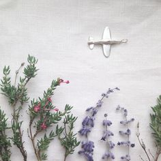 ♥Silver pendant with a story to tell ♥ THE SILVER SPITFIRE from silverpebble-The original version of this tiny silver spitfire was made of metal kept by her client in memory of her client's grandfather who served the RAF. Read the blog on http://bit.ly/1KAKmFw