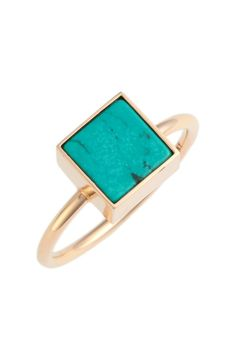 In love with this modern yet luminous gold ring that is topped with turquoise.