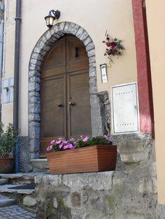 Doors + stone arch