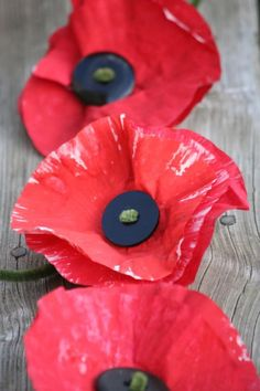 3 poppies made out of painted cupcake liners