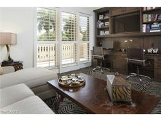4021 Gulf Shore Blvd N, Naples, FL 34103 | Tropical home office study den with zebra rug.  The Brittany at Park Shore.