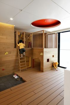 C.O Kindergarten and Nursery / HIBINOSEKKEI + Youji no Shiro, clubhouse, playspace in classroom, kids, wood floors and casework, climbing structure
