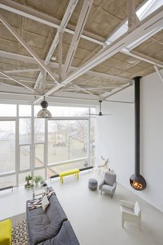 Loft Conversion in Amsterdam Groups Small Houses Inside a House - http://freshome.com/loft-conversion-in-amsterdam-groups-small -houses-inside a-house/