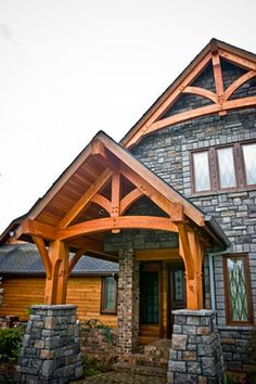 Craftsman style open curved beam entry exterior for Open beam front porch
