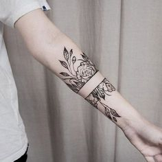 Black ink rose tattoo with split in the same arm by dogma_noir