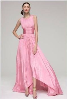 Oscar de La Renta PLEATED GOWN. A COLLECTION HIGHLIGHT, THIS SOFTLY PLEATED YET FLOWING GOWN IN BEGONIA IS PERFECT FOR SUMMER. 100% SILK.
