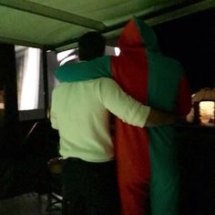 """Lol!! A """"snuggie"""" wearing X-mas elf hugging Cavill...sorry I can't stop the giggles!! ;)"""