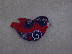 Stuffed Bird Pin in blue, red and white