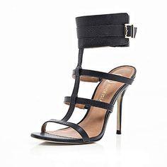 Black cuffed stiletto sandals £75.00