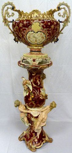 """Eichwald company. This amazing piece has a pedestal adorned with a figural bird, cherubs and floral decoration. Mounted atop of the pedestal is an urn with figural cherub and floral decoration. Urn is also decorated with a figural bird design which is common to Eichwald. Urn signed to bottom. 19th century. Measures 62 3/4"""" height (159.4cm).(Pre-Sale estimate $5000-$7000)"""