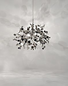 TErzani light fixture - wonder if could diy by fusing washers or thin mirrors together