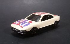 1980s Yatming BMW 850i Tan White Red Star Stripes Bird #4 Sport No. 804 Die Cast Toy Car https://treasurevalleyantiques.com/products/1980s-yatming-bmw-850i-tan-white-red-star-stripes-bird-4-sport-no-804-die-cast-toy-car #Vintage #1980s #80s #Eighties #Yatming #BMW #BMW850i #Tan #Cream #White #Purple #Stars #Stripes #Bird #Sport #Diecast #Toys #Cars #Collectibles #Vehicles #Automobiles