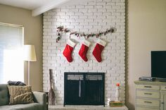 it's beginning to look a lot like christmas. — ashlee gadd no mantle? hang stockings from a garland Christmas Fireplace, Fireplace Mantle, Modern Christmas, Christmas Fun, Christmas Projects, Holiday Fun, Hanging Picture Frames, Christmas Interiors, Modern Fireplace