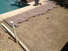 Pavers, drainage and gas line conduit - DIY fire pit with hidden propane tank