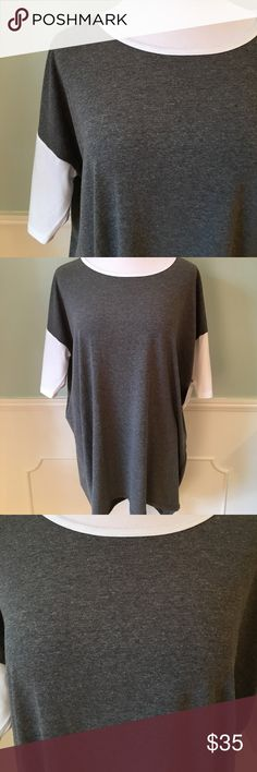 "NWT! LuLaRoe Irma Tunic NWT! LuLaRoe's Irma Tunic is a loose, knit ""high-low"" tunic with fitted mid-length sleeves. Poly/Spandex Blend. LuLaRoe Tops Tunics"