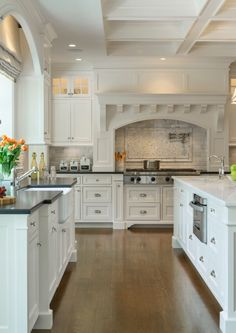 Kitchen with dark cabinets and white quartz counters for Classic timeless kitchen designs