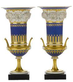 A pair of Paris porcelain floral encrusted two handled urns, second quarter 19th century.