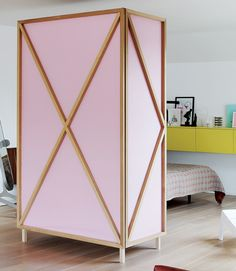 Wardrobe photo # 3, wings fully folded in to side and front looks like a plain armoire, not actual room divider