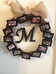 Picture wreath with dollar tree picture frames, a wreath from hobby lobby. And the bow is made from burlap ribbon from hobby lobby. I painted the wooden letter for the middle to hang and attached it with jute from the back. I attached it all with hot glue and since hanging on the wall, it has stayed together very well. Does not transport well.