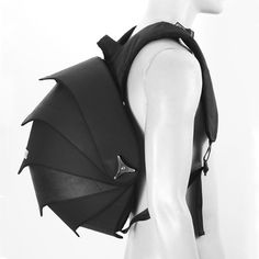 Pangolin Bag  Handmade Fair trade backpack Pangolin. Urban backpack made of recycled inner tubes of trucks. The design of this backpack is very inventive and striking by using overlapping sliding parts, it seems like a Pangolin. The parts are alternately covered with recycled inner tubes of trucks attached to each other with a wing nut.