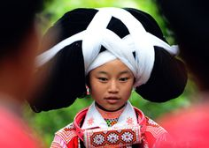 Photo taken on August 20, 2013 shows Long-horn Miao Nationality girls with huge horn-shaped headdresses at a museum of Suojia Villlage, southwest China's Guizhou province. Suojia Villlage is home to the Long-horn Miao, one of the small branches of Miao nationality.