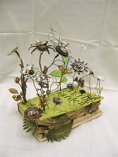 Margaret Harvey in Cobham...made from found treasures, and deftly put together, this vintage gardening book has exploded with life!