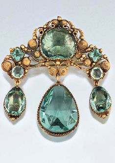 An early 19th century paste brooch  Of girandole design set with 'aquamarine'…