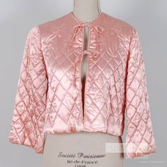 Bed Jacket Quilted Pink Hand Made Vintage 60's. This is similar to the one that my mom had, although hers had a peter pan collar and is a very light pink.