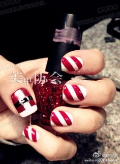 Santa nails. Super cute with candy canes and santa on the thumb. Super easy, all you need is so tape, white, black and red polish and clear to finish it off for the shine. #christmasnails #nailart