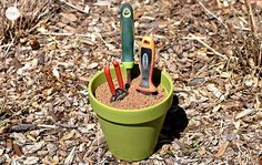 Make your own self-cleaning & self-sharpening garden tool holder. | 23 Cheap And Easy Tricks Every Gardener Should Know