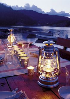 silver lanterns & candle holders on the lake