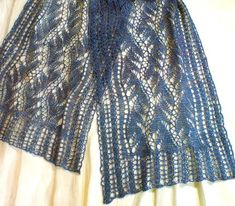 Lead or Follow Lace Scarf in hand-spun silk yarn. This scarf is true knitted lace; i.e. lace hole patterning is knit on every row. HeartStrings knitting pattern #A52