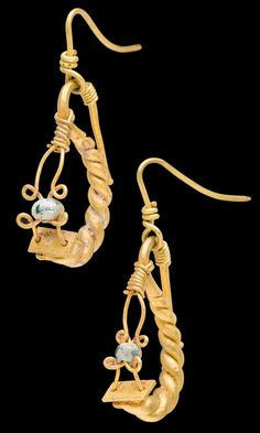 Jewelry Auction - Nov 30th 2016 - Later Imperial Roman gold Earrings with glass beads. Mounted on removable modern gold earwires for wear. Earrings of twisted thick solid tapered wires, with frontal green glass beads strung on thin gold wires. Beads with iridescent patina. Unusually good conditon for the type. 3d Century AD, probably Italy. This and more important art for sale on CuratorsEye.com