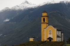 The San Sebastiano Church in Bellinzona, Switzerland, has a gorgeous vista of the Swiss Alps.