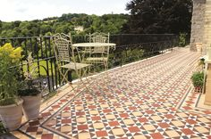 Victorian Floor Tiles - The Lambeth pattern with Wordsworth border is perfect for a pretty terrace area and creating a statement.