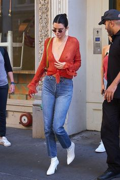 Kendall Jenner's Best Style Moments via @WhoWhatWearAU | Kendall Jenner in Bec & Bridge red tie-up top, blue jeans and white pointed boots