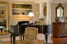 Spectacular Music Room decorating ideas for Lovely Living Room Traditional design ideas with cabinet crown molding doric columns hardwoods large wall mirror leopard occasional chair