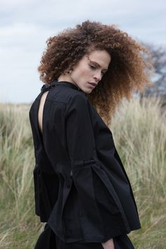Cotton shirt with flared sleeves and hand beaded details  #flaredsleeves #cottonshirt #blackshirt #fashionshoot #lookbook