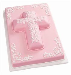 Paisley Communion Cross Cake  Distinctive in pink, this cake is perfect for your girl's baptism, christening, communion or other religious event! The Wilton Baroque Designs Fondant Mold and Cross Cake Pan make the details of this design easy to do.