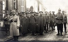 WWI. German soldiers belonging to the 26th Reserve Division and a collection of British prisoners-of-war, pause for a quick photograph. Definitely 1915 or later.  The 26th Reserve Division spent World War I on the Western Front. It fought in the Battle of the Frontiers and then participated in the Race to the Sea, fighting in the Somme region. It occupied the line in the Somme/Artois region into 1916, facing the British offensive in the Battle of the Somme.