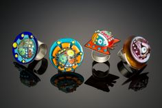 Enameled copper and lampwork glass Rings. Kathryn Guler