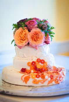 Vanilla chantilly cake with chocolate ganache and topped with real flowers and edible flower shaped candies.